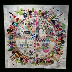 Just finished Round the Garden by Wendy Williams. Hand appliqued, machine quilted.