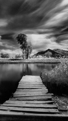 Quiet and lonely river with a dock near by allows a moment of silence to creep in so silent it takes your breath away.