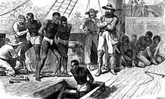 Captives being brought on board a slave ship. Britain outlawed slavery in 1833 but the transatlantic trade in African slaves continued.