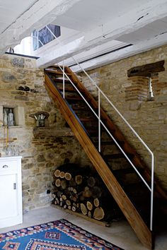wooden stairs and white railing