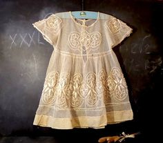 Here is an antique French baby christening dress with amazing embroidered details. This adorable dress has an amazing embroidered 1900s pattern and