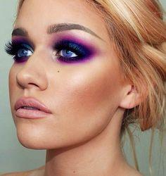 Bronzed makeup look with striking purple smoky eye.