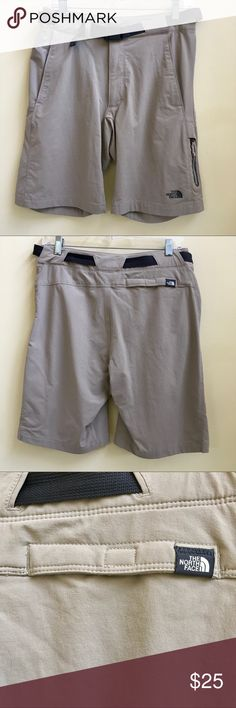 "The North Face Men's Adventure Shorts Khaki-colored nylon/elastase multi-purpose shorts. Had webbed belt with easy open push buckle. Button snap and front zipper. 2 front pockets, additional zip pocket at lower left front. One Velcro pocket in back. Light marker on inside next to tag with my last name, will work on removing, and see photo. Waist 30"" Length 19.5"" Rise 9"" Only worn once. EUC. The North Face Shorts"