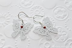 """365 day project Butterfly ♥ DAY 107 ♥ Butterfly earrings, material: thin metal. I added heart rhinstones to """"spice it up"""" :)."""