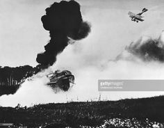 World War One saw the birth of the tank and the military airplane which forever changed the face of warfare, circa 1917. In this photograph a German fighter biplane is dive bombing a tank.