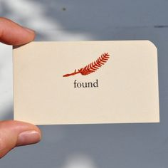 "Brooke Schmidt. 'Found'. A Vintge card hand-embroidered by her with a feather of thread. Size: 2"" x 3.5"". ""Legend has it that if you find a feather you are on the right path."" signed on the back by the artist, 2011. Brooke Schmidt/Etsy"