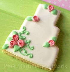 2. Decorated Wedding Cookies. A classic shape with raised roses and green vines.  Royal icing base and decorations.