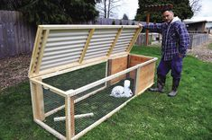Building a Chicken Coop - Build a chicken or rabbit tractor to help keep your animals safe and well-pastured all at the same time. Building a chicken coop does not have to be tricky nor does it have to set you back a ton of scratch. Rabbit Cages Outdoor, Outdoor Rabbit Hutch, Rabbit Pen, Rabbit Farm, Rabbit Cage Diy, Rabbit Hutch Plans, Rabbit Hutches, Rabbit Hutch And Run, Meat Rabbits