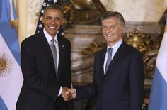 U.S. President Barack Obama shakes hands with Argentina's President Mauricio Macri at the government house in Buenos Aires, Argentina, Wednesday, March 23, 2016. Obama is on a two day official visit to Argentina.  (David Fernandez/Pool Photo via AP)