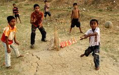 A group of Middle-Eastern boys playing cricket