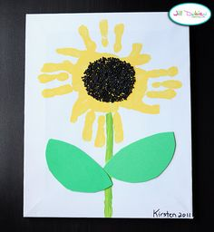 Handprint Sunflower. Instead of beads for the center, we'll probably just do the kids fingerprints over and over.