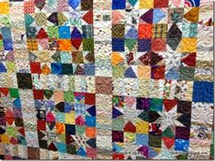 Fantastic scrape quilt, Bonnie's Wonky Wishes, with edge to edge design called Je t'aime by Urban Elementz