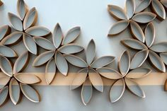 Wall Accents: From paper towel tubes to cupcake wrappers...  25 DIY Wall Art Ideas - Decoist