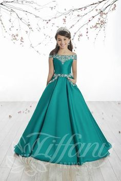 Tiffany Princess 13513 has beading around the drop shoulder neckline and a beaded waistline. This girl's pageant gown features front pockets with beaded edges on an A-line Mikado skirt with sweep train, and a lace-up back. Pagent Dresses For Kids, Pageant Dresses For Women, Dresses For Tweens, Gowns For Girls, Little Girl Dresses, Cute Dresses, Beautiful Dresses, Girls Dresses, Princess Dresses For Girls