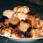sugared campfire donuts  1/2 cup sugar  1/4 tsp cinnamon  1 can refrigerated biscuit doug  3 Tbsp melted butter  -mix together sugar and cinnamon in bowl, set aside  -cut each bisquit into thirds & roll into balls  -skewer on a toasting fork, cook over hot coals, turning constantly, until golden brown  -dip in melted butter, thenroll in cinnamon sugar