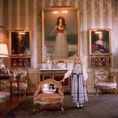 Caption: 1976, Eugenia Martinez de Irujo, daughter of the 18th Duchess of Alba, standing before Goya's portrait of the 13th Duchess of Alba, Madrid, Spain. (Photo by Slim Aarons/Getty Images)   Artist: Slim Aarons Date: 1976
