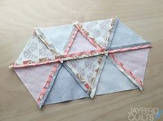For this tutorial I am going to show you how to sew 60-degree triangles together into pairs, then rows & then put the rows together. ...