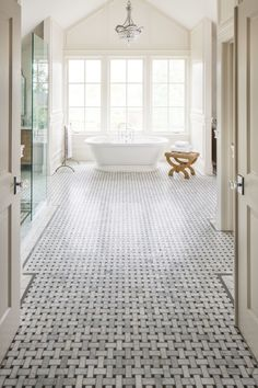This bathroom used white marble mosaic with basket weave design on the floor and it looks marvelous. The design of the floor tiles was designed to look ...