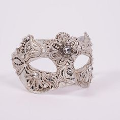 Colombina Macrame Silver.This is the most feminine of all masks: delicate with lace, decadent with jewel and bead embellishments, and regal with it's shimmery silver finish. vivomasks.com