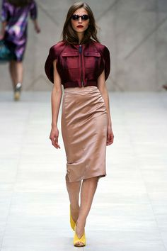Burberry Prorsum. Spring 2013 Ready to Wear. Burberry's collection consists of loud, bold colours and sumptous fabrics. This burgundy attire caught my eye for its European chic look and architectural sleeves.