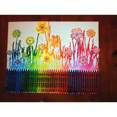 Melted crayon art with scrapbooking flowers.