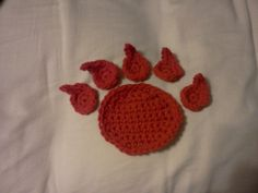 Bear Paw Crochet Pattern available for purchase at http://www.ravelry.com/patterns/library/bear-paw-applique $2.50 (not a finished product)