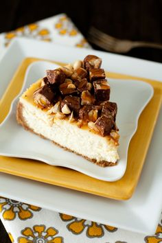 Snickers Cheesecake - Mini Chocolate Snickers; roasted peanuts, caramel syrup  This cheesecake recipe is deliciously indulgent and perfect for anyone that loves ooey gooey Snickers bars.