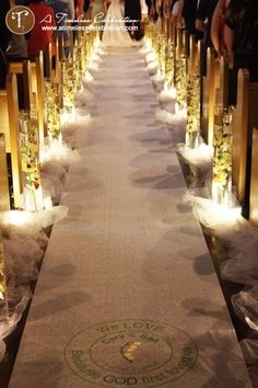 Courtesy of ATimelessCelebration.com....another unique aisle decor...don't really like the runner, just the side decor