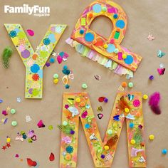 Mixed-media Monograms: For a letter-perfect collage project, brush a base color of acrylic paint onto a chipboard initial, then use tacky glue to attach sequins, tissue paper scraps, pom-poms, feathers, and more.