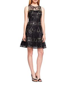 Metallic detailing and a flattering fit-and-flare shape make this dress a showstopper. Kay Unger