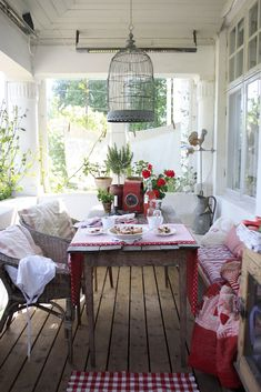Gorgeous porch and a bird cage