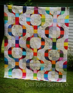 Mod Pop with low volume background and bright solids for the pop | Old Red Barn Co.: Latest quilt