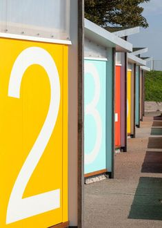 Stones and shells from the seashore fill the walls of these eight contemporary British beach huts that Pedder & Scampton designed for Southend. Colour Architecture, Amazing Architecture, Architecture Details, Environmental Graphic Design, Environmental Graphics, British Beaches, Wayfinding Signage, Built Environment, Visual Communication