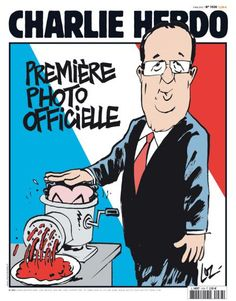 First official photo of newly elected Hollande, pushing Sarkozy into a meat grinder.