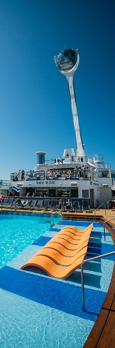 Get some sun on your next Anthem of the Seas vacation. Lounge chairs are permanent fixtures in the main pool, offering the best view of the North Star.
