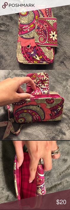 Vera Bradley All-in-One Wristlet Paisley meets plaid patterned pink and purple wallet/phone holder. Is meant for IPhone 5 but I'm sure you could store other things in the pocket. Used a little but in great condition and no signs of wear. Contains 3 cars slots, a coin pouch and a slot for money or receipts! Vera Bradley Bags Wallets