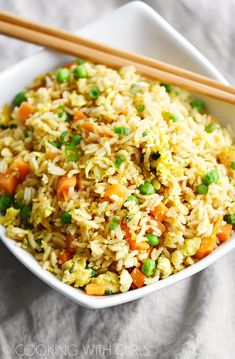 You won't believe how easy this Instant Pot Fried Rice is to prepare! It's the perfect side dish or quick meal any night of the week! © COOKING WITH CURLS