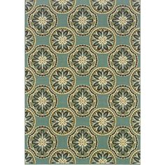 Caprina Blue/Ivory outdoor rug- won't slide around on the sealed concrete and is easy to clean.