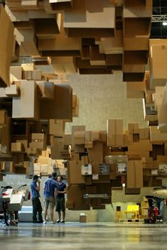 An Exhibition Featuring A Giant Pixelated Cloud Made Of Suspended Cardboard  Boxes Designed By Architects Fantastic