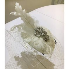 As a bride you may decide not to go for a traditional veil but something a little different a little bit vintage but will certainly receive a lot of compliments!  The gorgeous curls on the delicate feathers teamed with the vintage looking pearl and crystal embellishment look so sophisticated.  A veiled fascinator can be a great way to add veiling without  adding length if you wish to keep your dress completely uncovered by anything else and remain the star of the show.   #lesleycutlerbridal…