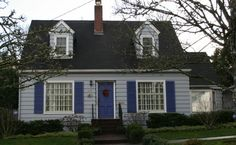 CAPE COD characteristics:clapboard or shingle siding; Typically 1 1/2 story; Usually have a steep pitched roof w/end gables; Often simple, w/little ornamentation;  Symmetrical;  Designed to blend in w/the environment, w/natural colors & materials; Often has master bedroom on the main & the kids bedrooms upstairs; Rarely have front porches, but often have screened in porches on 1 side; The front door is often painted in a distinct color, can be intricately carved, & bear an ornament or wreath...