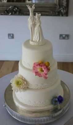 Cassandra: 3-tier Ivory Wedding Cake with Lace Trim and Fresh Flowers