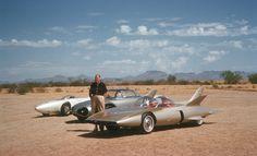 Harley Earl with the General Motors Firebird I, II, and III at the General Motors Desert Proving Ground in Mesa, Arizona.