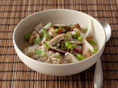 Chicken-Scallion Rice Bowl : Strong Asian flavors shine through in a scented broth that uses shiitake stems and scallions, along with a hefty amount of garlic, ginger and basil. Poached chicken breasts and edamame provide protein.