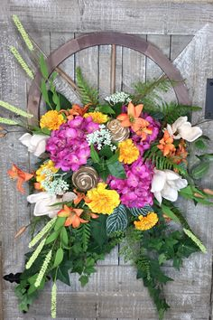 A personal favorite from my Etsy shop https://www.etsy.com/listing/603059809/summer-wreath-for-front-door-wagon-wheel