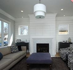 I love the mix of the cement fireplace with the shiplap. I would actually remove all the stone, take a large wood mantel run it the entire length of the fireplace. Do cement tile on the bottom and shiplap above onto the slanted wall. Basement Living Rooms, Basement Fireplace, Cottage Fireplace, Shiplap Fireplace, Farmhouse Fireplace, Home Fireplace, Fireplace Remodel, Fireplace Design, My Living Room