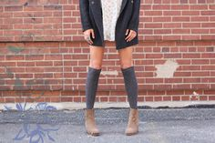 I love wearing tights come winter, but there weather isn't quite cold enough yet to start wearing them, so instead we're transitioning into winter with tall socks. From thigh high to knee high to ribbed, patterned and woolen, we styled some of our favorite pairs right now with dresses and jeans. Come the weekend or