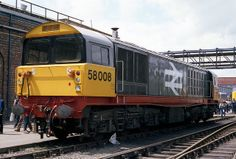 58008 at Crewe Works open day on the 2nd June 1984. Built at Doncaster Works and delivered on 6th Feb 1984. In 2014 stored at Eastleigh Depot as part of DBS Stored Locomotives Group 4.