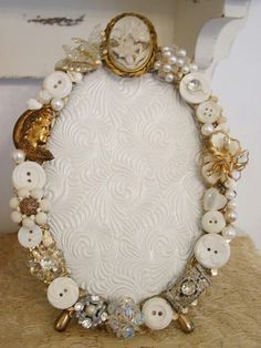 My grandmother has buckets and boxes full of buttons. I kept them and am happy I did. I found some wonderful things you can make with the buttons. This one is simple enough. Glue them on a mirror or picture frame and your good to go.