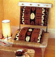 AFRICAN DESIGNED CHAIR IS PERFECT IN A LIVING ROOM OR BEDROOM.